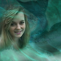 young mermaid sitting in water