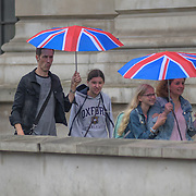 UK Weather:  Pedestrians holding a union jack umbrella in Rainy London, UK. 19 July 2019.