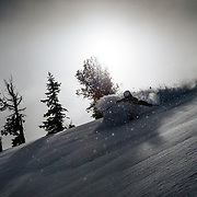 Tanner Flanagan gets backlit powder deep in the Teton backcountry after a massive winter storm.