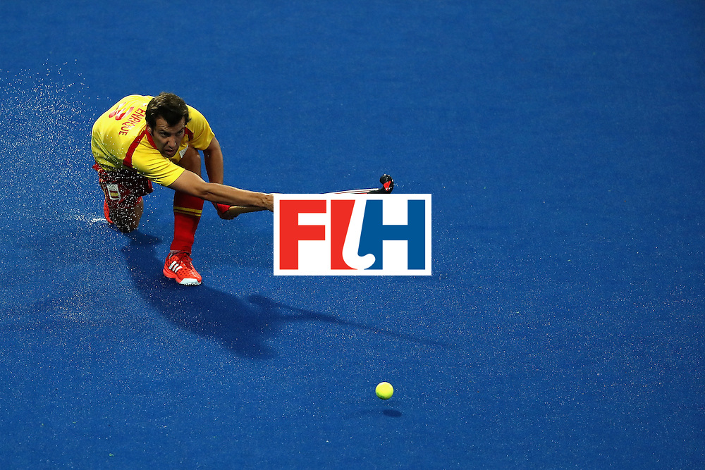 RIO DE JANEIRO, BRAZIL - AUGUST 12: Sergi Enrique #3 of Spain passes against Great Britain during a Men's Preliminary Pool B match on Day 7 of the Rio 2016 Olympic Games at the Olympic Hockey Centre on August 12, 2016 in Rio de Janeiro, Brazil.  (Photo by Sean M. Haffey/Getty Images)