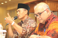 November 1, 2018 - Madiun, East Java, Indonesia - Mayor of Madiun H. Sugeng Rismiyanto [left] accompanied by Head of Representative of Bank Indonesia Kediri, Djoko Raharto [right] delivered a presentation during a press release in the meeting room of one of the hotels in Madiun City. The press release is related Bank Indonesia will hold an Economic Seminar, Respondent Gathering, the Small and Medium Micro Business Festival and the National Payment Gate Campaign for three days. This is in the context of Regional Economic Development after Trans Java Toll Road and Double Track Railway  (Credit Image: © Ajun Ally/Pacific Press via ZUMA Wire)