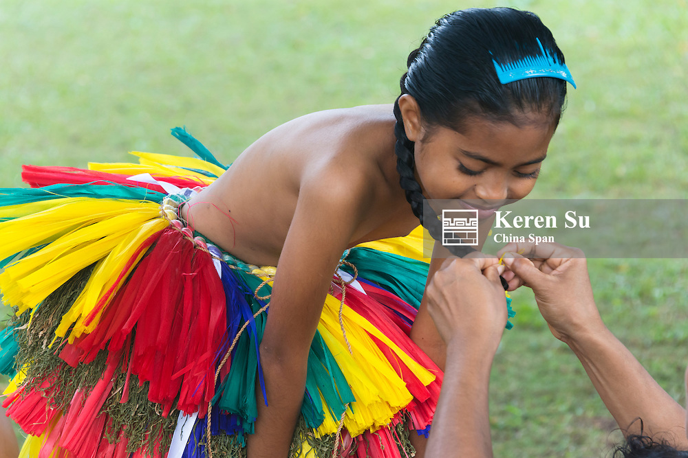 Braiding pony tail for the little Yapese girl at Yap Day Festival, Yap Island, Federated States of Micronesia