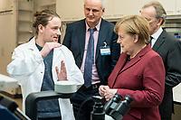 26 FEB 2019, BERLIN/GERMANY:<br /> Angela Merkel (R),  CDU, Bundeskanzlerin, laesst sich von Jonathan Alles (L), Doktorand aus dem Labor von Nikolaus Rajewsky eerklären, wie Single Cell Sequencing mit den neuen Technologien der Einzelzellanalyse im großen Maßstab und mit hoher Präzision beobachten kann, (im Hintergrund Prof. Dr. Nikolaus Rajewsky (L) und Prof. Dr. Martin Lohse (R)), waehrend einem Rundgang der Kanzlerin durch das Labor anl. der Eroeffnung des zweiten Standorts des Max-Delbrueck-Centrums fuer Molekulare Medizin (MDC) in Berlin-Mitte<br /> IMAGE: 20190226-01-0<br /> KEYWORDS: Max-Delbrück-Centrum