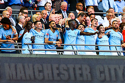 Riyad Mahrez of Manchester City  sings with Phil Foden and his other new teammates as Manchester City celebrate winning 2-0 - Rogan/JMP - 05/08/2018 - FOOTBALL - Wembley Stadium - London, England - Chelsea v Manchester City - The FA Community Shield.