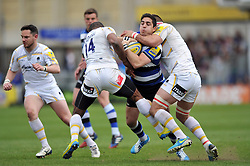 Horacio Agulla (Bath) is double-tackled in possession - Photo mandatory by-line: Patrick Khachfe/JMP - Tel: Mobile: 07966 386802 19/04/2014 - SPORT - RUGBY UNION - The Recreation Ground, Bath - Bath Rugby v Worcester Warriors - Aviva Premiership.