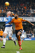 Queens Park Rangers goalscorer Sebastian Polter looks to chase a long ball down contested with Wolverhampton Wanderers defender Ethan Ebanks-Landell during the Sky Bet Championship match between Queens Park Rangers and Wolverhampton Wanderers at the Loftus Road Stadium, London, England on 23 January 2016. Photo by Andy Walter.