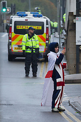 © Licensed to London News Pictures . 12/10/2013 . Bradford , UK . An EDL supporter wearing a Union Jack onesie at the demonstration . The EDL hold a demonstration in Bradford today (Saturday 12th October 2013) . It is their first demonstration since leaders Stephen Yaxley-Lennon (aka Tommy Robinson ) and Kevin Carroll quit . Approximately 500 protesters gathered near the city centre . Photo credit : Joel Goodman/LNP