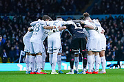 Leeds United players huddle during the EFL Sky Bet Championship match between Leeds United and Cardiff City at Elland Road, Leeds, England on 14 December 2019.