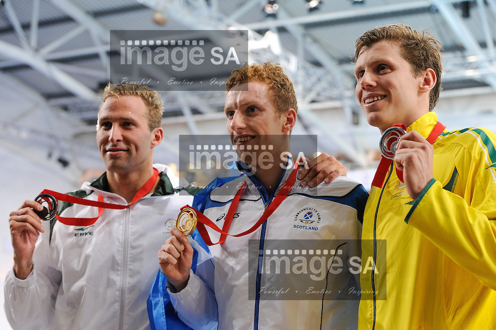 GLASGOW, SCOTLAND - JULY 25: Sebastien Rousseau of South Africa (bronze), Daniel Wallace of Scotland (gold) and Thomas Fraser-Holmes of Australia (silver) with their medals in the mens 400m Individual Medley during the swimming on day 2 of the 20th Commonwealth Games at Tollcross Swimming Centre on July 25, 2014 in Glasgow, Scotland. (Photo by Roger Sedres/ImageSA)