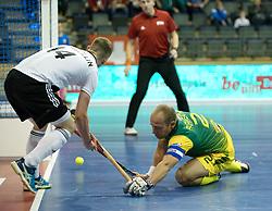 BERLIN - Indoor Hockey World Cup<br /> Men: Russia - South Africa<br /> foto: FAIRWEATHER Matthew (C) defending.<br /> COPYRIGHT WILLEM VERNES