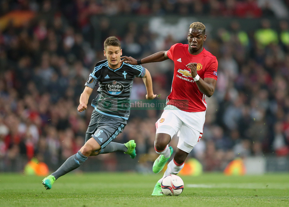 Manchester United's Paul Pogba (right) and Celta Vigo's Nemanja Radoja battle for the ball during the UEFA Europa League, Second Leg match at Old Trafford, Manchester.