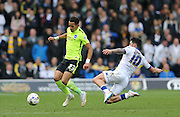 Brighton defender, full back, Liam Rosenior (23) gets away from Leeds United midfielder Alex Mowatt (10) during the Sky Bet Championship match between Leeds United and Brighton and Hove Albion at Elland Road, Leeds, England on 17 October 2015.