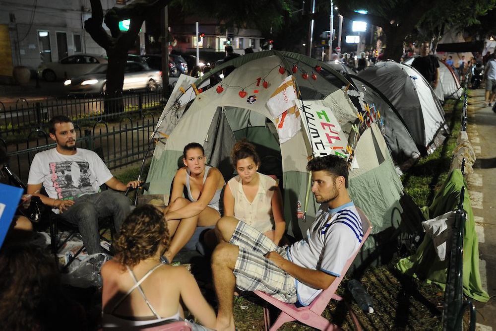 TEL AVIV, ISRAEL - JULY 25, 2011: Israelis attend the demonstration tent camp in Tel Aviv, demonstrating agains rising housing prices. Over the past two weeks, Israelis have set up tent camps in many cities throughout Israel, and protested calling attention to the rising cost of living.