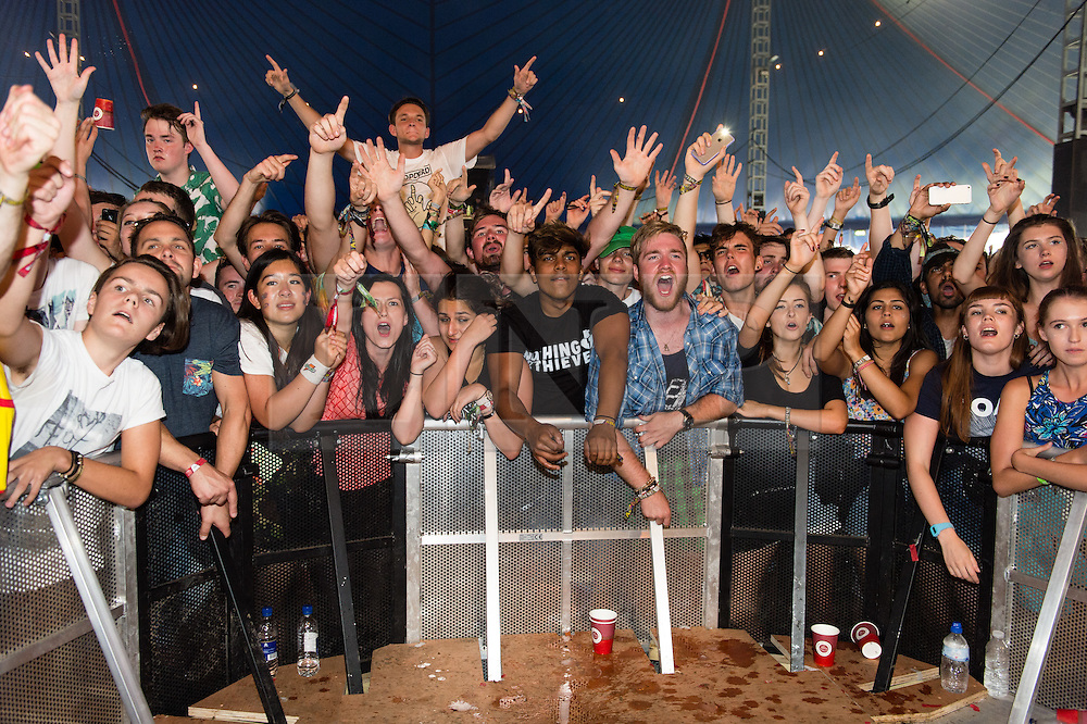 © Licensed to London News Pictures. 29/08/2015. Reading Festival, UK.  Festival goers watch Foals performing a surprise set at Reading Festival 2015, Day 2.  Photo credit: Richard Isaac/LNP