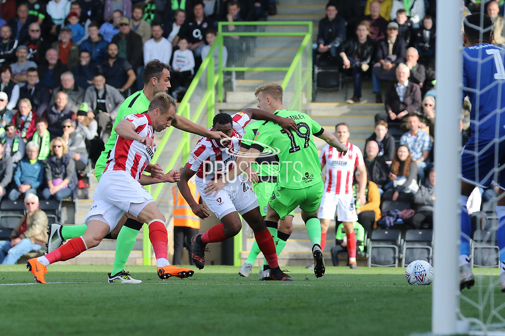Luke Varney and Tyronne Bennett on the attack during the EFL Sky Bet League 2 match between Forest Green Rovers and Cheltenham Town at the New Lawn, Forest Green, United Kingdom on 20 October 2018.