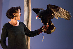 "***LNP BEST OF WEEK SELECTION***© Licensed to London News Pictures. 06/05/2014. London, England. Pictured: Fiona Shaw performing with Inti, a six-year old Turkey Vulture (Cathartes aura). ""The Testament of Mary"" performed by actress Fiona Shaw at the Barbican Theatre, London. Running from 1 to 25 May 2014. Directed by Deborah Warner based on the novel by Colm Tóibín. Photo credit: Bettina Strenske/LNP"
