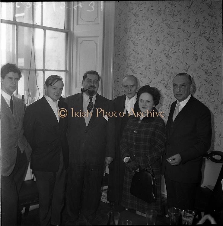 25/01/1962<br /> 01/25/1962<br /> 25 January 1962<br />  Dr Paul Singer (with pipe), celebrates his acquittal following the longest trial in State history up to that time, the trial lasted 47 days until Mr Justice Walsh directed the jury to return a &quot;not guilty&quot; verdict on eight counts of fraud arising from the operations of Shanahan's Stamp Auctions Ltd, Dun Laoghaire. It was Singer's 262nd day in court since proceedings were started against him four years earlier.  Also present is Senior Council, Mr. Sean McBride, third from left and Mrs Irma Singer,second from left.