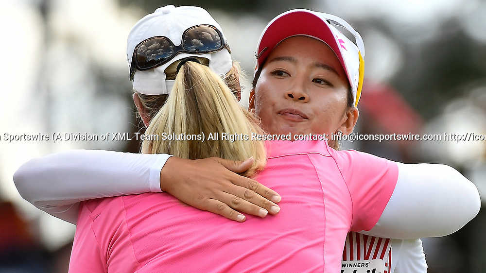 OLYMPIA FIELDS, IL - JULY 01: Chella Choi of South Korea hugs Brittany Lincicome on the 18th green during the third round of the 2017 KMPG PGA Championship at Olympia Fields on July 1, 2017 in Olympia Fields, Illinois. (Photo by Quinn Harris/Icon Sportswire)