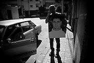Romani with Medo's portrait on his way home. Nag Hamadi, Egypt.