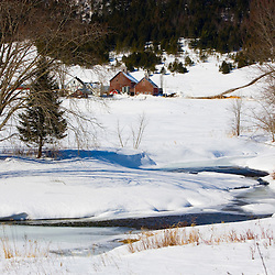 A farm on the banks of Indian Stream in winter.  Pittsburg, New Hampshire.  Connecticut River tributary.
