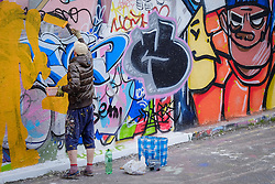 A graffiti artist working in Leake St, Waerrloo, London.