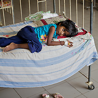 A patient in the Valaichenai Base Hospital pediatric ward built by UNICEF in 2008. The hospital serves the 100,000 Tamil and Muslim community of Valaichenai who are tsunami and conflict-affected community. The pediatric ward can accommodate up to 200 children. The government are in the process of developing a maternity ward in the same building. <br /> <br /> Photo: Tom Pietrasik<br /> Batticaloa District, Sri Lanka<br /> September 28th 2009