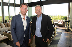 An exclusive preview of the new Samsung OLED Curved TV has hosted by Nick & Holly Candy at their home at One Hyde Park, London on 29th August 2013.<br /> Picture shows:-Nick Candy and Andy Griffiths, Managing Director Samsung UK.