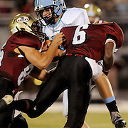 South Brunswick's Hunter French is tackled by Ashley's Mike Rowland, left and Andre Stukes. (Jason A. Frizzelle)