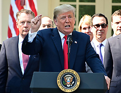 October 1, 2018 - Washington, District of Columbia, U.S. - United States President Donald J. Trump answers reporter's questions following his remarks on the United States Mexico Canada Agreement (USMCA) in the Rose Garden of the White House in Washington, DC on Monday, October 1, 2018.  The President also took questions on the Kavanaugh nomination.  Visible behind the President are US Trade Representative Robert Lighthizer, left, and US Secretary of the Treasury Steven T. Mnunchin, right  (Credit Image: © Ron Sachs/CNP via ZUMA Wire)
