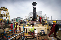 "© Licensed to London News Pictures. 04/05/2016. Birkenhead UK. Picture shows restoration work being carried out on the Daniel Adamson at Camel Laird docks in Birkenhead. The Daniel Adamson steam boat has been bought back to operational service after a £5M restoration. The coal fired steam tug is the last surviving steam powered tug built on the Mersey and is believed to be the oldest operational Mersey built ship in the world. The ""Danny"" (originally named the Ralph Brocklebank) was built at Camel Laird ship yard in Birkenhead & launched in 1903. She worked the canal's & carried passengers across the Mersey & during WW1 had a stint working for the Royal Navy in Liverpool. The ""Danny"" was refitted in the 30's in an art deco style. Withdrawn from service in 1984 by 2014 she was due for scrapping until Mersey tug skipper Dan Cross bought her for £1 and the campaign to save her was underway. Photo credit: Andrew McCaren/LNP ** More information available here http://tinyurl.com/jsucxaq **"
