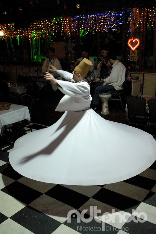 During the rotation, the dervish seems to be flying on the ground