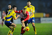 Accrington Stanley's Joe Wright and Exeter City's Jayden Stockley during the Sky Bet League 2 match between Exeter City and Accrington Stanley at St James' Park, Exeter, England on 23 January 2016. Photo by Graham Hunt.