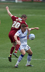 BIRKENHEAD, ENGLAND - Saturday, April 21, 2012: Tranmere Rovers' Jake Cassidy in action against Hartlepool United's Adam McGurk during the Football League One match at Prenton Park. (Pic by David Rawcliffe/Propaganda)