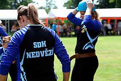 CZECH REPUBLIC VYSOCINA NEDVEZI 2AUG14 - Voluntary female firefighters perform during a race on the village common in Nedvezi, Vysocina, Czech Republic.<br /> <br /> .<br /> <br /> jre/Photo by Jiri Rezac<br /> <br /> <br /> <br /> &copy; Jiri Rezac 2014