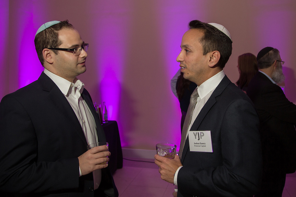 FEBRUARY 5, 2015----MIAMI, FLORIDA---PHOTO BY ANGEL VALENTIN<br /> Matthew Kushner, 28, left, talks with Joshua Emory, 31, in the  Rok Family Shul Chabad Downtown Jewish Center in the Brickell area of Miami. The center hosted a networking roundtable event for young Jews, mostly non-Orthodox. Real Estate investment and development was the topic discussed.