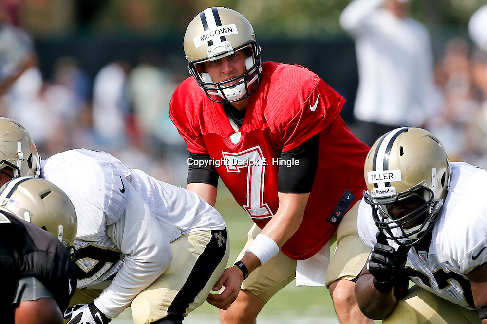 Aug 3, 2013; Metairie, LA, USA; New Orleans Saints quarterback Luke McCown (7) during a scrimmage at the team training facility. Mandatory Credit: Derick E. Hingle-USA TODAY Sports