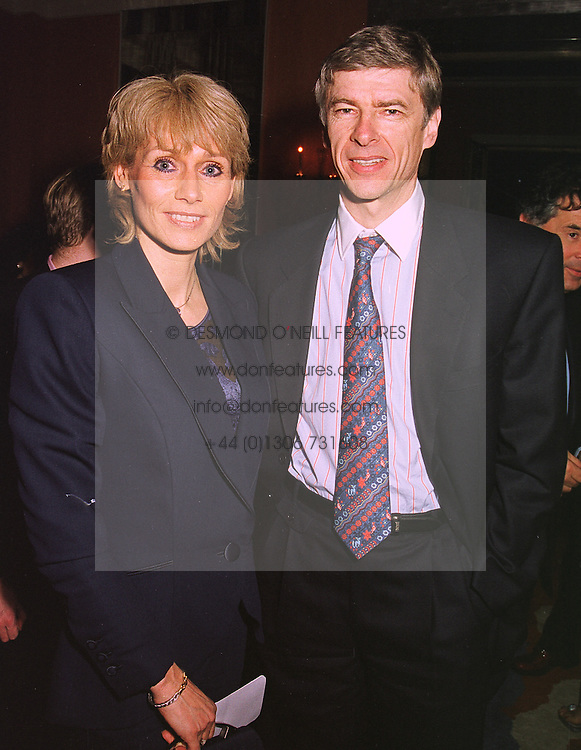 Arsenal Football club manager MR & MRS ARSEN WENGER, at a party in London on 4th February 1999.MOB 29