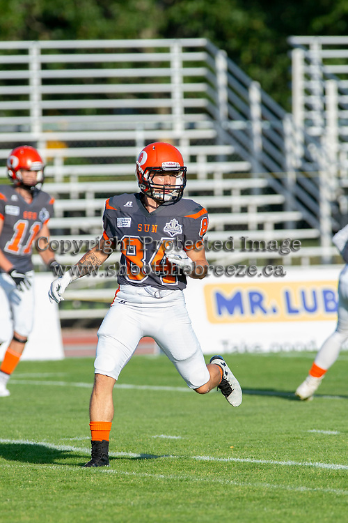 KELOWNA, BC - AUGUST 3:  Javen Kaechele #84 of Okanagan Sun warms up on the field against the Kamloops Broncos  at the Apple Bowl on August 3, 2019 in Kelowna, Canada. (Photo by Marissa Baecker/Shoot the Breeze)