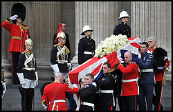 Lady Thatcher's coffin is carried out of St Paul's Cathedral after her funeral following her death last week, London, UK, Wednesday 17 April, 2013, Photo by: Andrew Parsons / i-Images