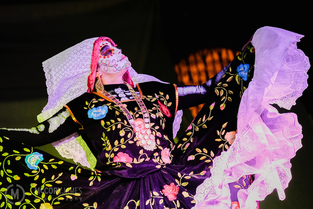 A dancer performs during Dia de los Muertos celebrations