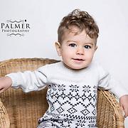 Child sitting in wicker chair