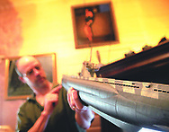 Anderson talks about the methods he used to make wear and tear appear on this submarine model.  Photo by Elliot Knight