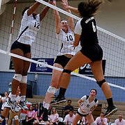 On Friday, November 4, during the Golden West College vs. Irvine Valley College women's volleyball game, Marina Adolpho (6) on Golden West spikes the ball into Irvine Valley's two blockers, Hailey Riden (10) and Diamonique Brogan (12) in Irvine, CA. Golden West won all three games against Irvine Valley College. <br /> <br />  Photograph taken by ©Mikailin Rae Perry, Sports Shooter Academy