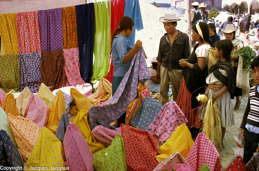 Textiles on sale at market in village in Oaxaca State Mexico