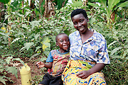 Eric Niringiyinana aged 4 with mother Clarisse Nyirancamubanzi, .Collecting water from the Akagera river.  Gatora village. Juru Sector. Bugesera district. Rwanda...© Zute Lightfoot / Water Aid.