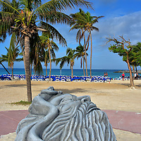 Poseidon Sculpture at Great Stirrup Cay, Bahamas<br /> Poseidon, the Greek god of the sea, is the official greeter as you walk towards the beach. Surrounding the deity's head is his son, the merman Triton. Prior to a recent hurricane, a statue of Neptune occupied this spot. He is the Roman counterpart of Poseidon. This artwork is just for starters. If you like snorkeling, you will love exploring the island's underwater sculpture garden.