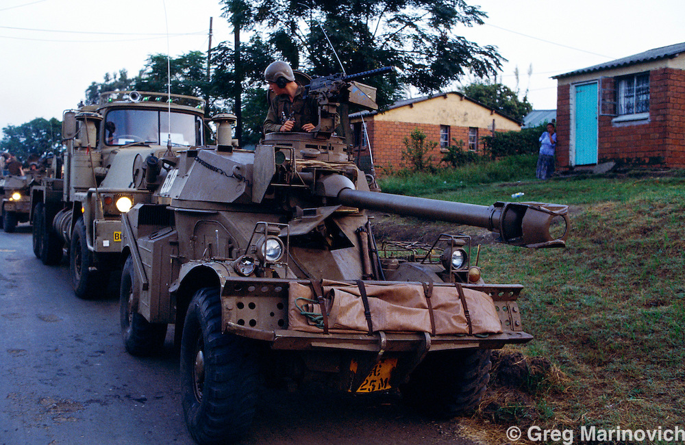 KwaMashu township, KwaZulu Natal, Durban, South Africa. Military convoy of armoured vehicles in KwaMashu after clashes between African National Congress and Inkatha Freedom Party supporters, 1994.
