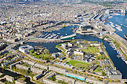 Nederland, Noord-Holland, Amsterdam, 09-04-2014;<br /> Overzicht Marineterrein (midden) en omgeving, onderin Kattenburg,met de klokmee: Scheepvaartmuseum, centrum Amsterdam,  Westerpark en Westerdok,  Centraal station, midden museum Nemo, IJtunnel en Oosterdokseiland, <br /> View Navy area (center) and the National Maritime Museum (white building), old town Amsterdam, Museum Nemo, top right central station. <br /> luchtfoto (toeslag op standard tarieven);<br /> aerial photo (additional fee required);<br /> copyright foto/photo Siebe Swart