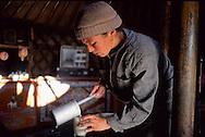 Mongolia. a mother preparing the milk for her baby in the yurt.  Argalant      /   une mere prepare le lait de son enfant dans la yourte. mili had village