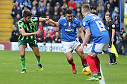 George Francomb of AFC Wimbledon and Enda Stevens battle during the Sky Bet League 2 match between Portsmouth and AFC Wimbledon at Fratton Park, Portsmouth, England on 15 November 2015. Photo by Stuart Butcher.